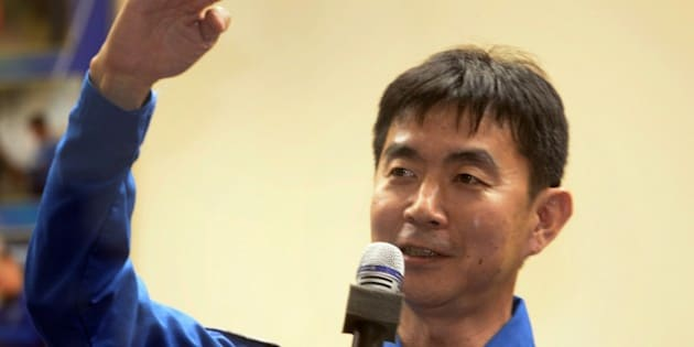 The Soyuz TMA-17M spacecraft crew member Japanese astronaut Kimiya Yui  talks to media during a preflight press conference at the Russian-leased Baikonur cosmodrome in Kazakhstan on July 21, 2015.  Russia's Soyuz TMA-17M spacecraft with two other members - US astronaut Kjell Lindgren, and Russian cosmonaut Oleg Kononenko is scheduled to blast off to the ISS from early on July 23, 2015.    AFP PHOTO / ALEXANDER NEMENOV        (Photo credit should read ALEXANDER NEMENOV/AFP/Getty Images)