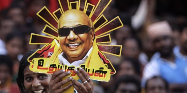 A supporter holds up a cutout with a portrait of Dravida Munnetra Kazhagam (DMK) party chief M. Karunanidhi during an election rally in Chennai, India, Tuesday, April 22, 2014. The multiphase voting across the country runs until May 12, with results for the 543-seat lower house of Parliament announced May 16. (AP Photo/Arun Sankar K.)