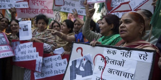 India's opposition Congress party's women activists hold placards during a protest after a woman was allegedly raped by a taxi driver in New Delhi, India, Monday, Dec. 8, 2014. The Indian capital on Monday banned taxi-booking service Uber after a woman accused one of its drivers of raping her.(AP Photo/Tsering Topgyal)