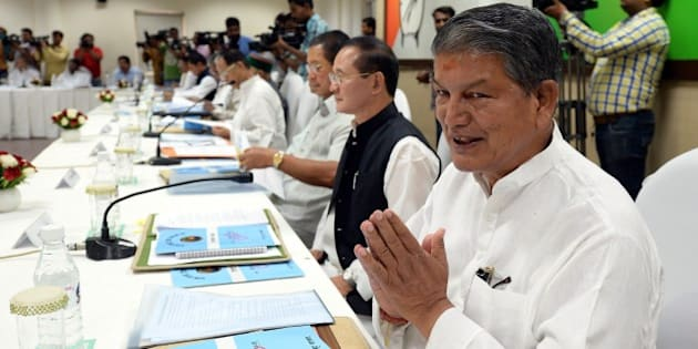 Uttarakhand Chief Minister Harish Rawat gestures during a meeting at party headquarters in New Delhi on June 9, 2015. Congress President Sonia Gandhi, Vice President Rahul Gandhi and General Secretaries met with the Chief Ministers of congress ruled states, to form a political strategy to take on the NDA Government at the Centre for its attitude towards Congress-ruled and other non- BJP states. AFP PHOTO/PRAKASH SINGH        (Photo credit should read PRAKASH SINGH/AFP/Getty Images)