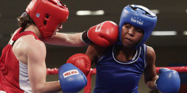 Canada's Mandy Marie Bujold, left, and Colombia's Ingrit Valencia fight during a women's 51 kg final boxing bout at the Pan American Games in Guadalajara, Mexico, Saturday, Oct. 29, 2011. Bujold won the gold and Valencia the silver. (AP Photo/Arnulfo Franco)