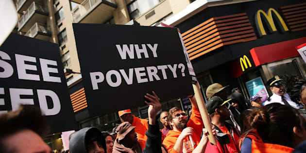 NEW YORK, NY - APRIL 15: Low wage workers, many in the fast-food industry, join with supporters in front of a McDonald's to demand a minimum wage of $15 an hour on April 15, 2015 in New York City. In what organizers are calling the biggest ever mobilization of workers in the U.S., thousands of people took to the streets across the country to stage protests in front of businesses that are paying some of their workers the minimum wage. Home care workers, and employees at Walmart and fast food restaurants say that the current minimum is not a living wage.  (Photo by Spencer Platt/Getty Images)