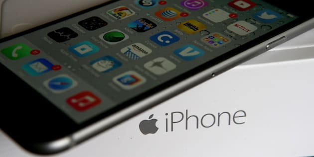 SAN ANSELMO, CA - JANUARY 27:  An Apple iPhone sits on a box on January 27, 2015 in San Anselmo, California.  Apple Inc. reported huge first quarter earnings that were fueled by strong iPhone sales with revenue of $74.6 billion compared to $57.6 billion one year ago.  (Photo Illustration by Justin Sullivan/Getty Images)
