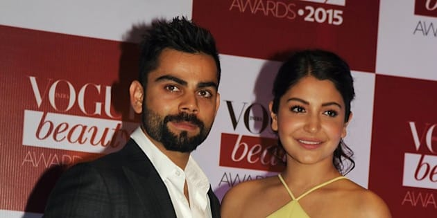 Indian Bollywood actress Anushka Sharma and Indian cricketer Virat Kohli (L) attend the Vogue Beauty Awards ceremony in Mumbai late on July 21, 2015. AFP PHOTO        (Photo credit should read STR/AFP/Getty Images)