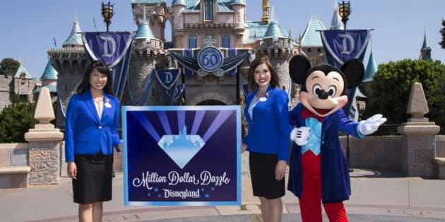 ANAHEIM, CA - JULY 17:  In this handout photo provided by Disney parks, MILLION DOLLAR DAZZLE - Mickey Mouse and the 2015 Disneyland Resort Ambassadors celebrate the exciting new philanthropic program, 'Million Dollar Dazzle,' announced during a ceremony celebrating the 60th anniversary of Disneyland park July 17, 2015 in Anaheim, California.  Each month during the Disneyland Resort Diamond Celebration, the Million Dollar Dazzle Crew will surprise one or more local nonprofits that exemplify Walt Disney Parks and Resorts Better Together philosophy with a $60,000 gift, totaling more than $1 million. Celebrating six decades of magic, the Disneyland Resort Diamond Celebration features three new nighttime spectaculars that immerse guests in the worlds of Disney stories like never before with 'Paint the Night,' the first all-LED parade at the resort; 'Disneyland Forever,' a reinvention of classic fireworks that adds projections to pyrotechnics to transform the park experience; and a moving new version of 'World of Color' that celebrates Walt Disneys dream for Disneyland.  (Photo by Paul Hiffmeyer/Disneyland Resort via Getty Images)