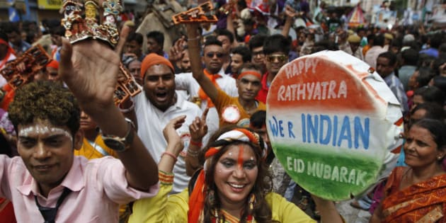 """Indian Hindu devotees dance during the """"Jagannath Rath Yatra"""" or the chariot festival of Lord Jagannath in Ahmadabad, India, Saturday, July 18, 2015. Rath Yatra was celebrated in various parts of the city on Saturday with colorful chariots of Lord Jagannath, his brother Balaram and sister Subhadra, being pulled by thousands of devotees that moved through the major city roads amid the joyous religious chants. (AP Photo/Ajit Solanki)"""