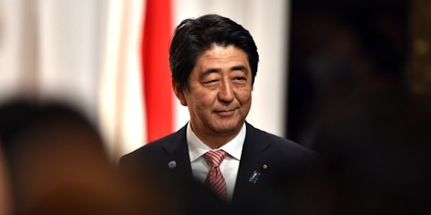Japanese Prime Minister Shinzo Abe smiles after he delivered a speech at the 50th anniversary ceremony for the normalizing relations between Japan and South Korea, hosted by the South Korean embassy in Tokyo on June 22, 2015.  South Korean Foreign Minister Yun Byung-Se is here to attend the ceremony.    AFP PHOTO / POOL / Yoshikazu TSUNO        (Photo credit should read YOSHIKAZU TSUNO/AFP/Getty Images)