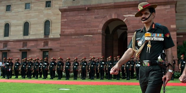 Incoming head of the Indian Army Lt. General Dalbir Singh Suhag inspects a guard of honour prior to joining office in New Delhi on August 1, 2014. Lt Gen Dalbir Singh Suhag has taken over as the head of the 1.3 million strong Indian Army, succeeding General Bikram Singh.  AFP PHOTO/Prakash SINGH        (Photo credit should read PRAKASH SINGH/AFP/Getty Images)