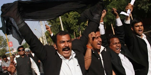 Indian lawyers shout slogans during a protest against the visit of Pakistani Prime Minister Raja Pervaiz Ashraf in Ajmer, India, Saturday, March 9, 2013. Ashraf is in India on a daylong private trip  to visit the shrine of Khwaja Moinuddin Chishti in Ajmer. Sufism is a more mystical form of Islam that is practiced in many parts of South Asia. (AP Photo/Deepak Sharma)