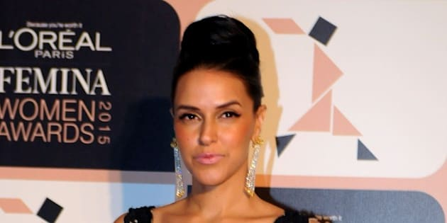 Indian Bollywood actress Neha Dhupia poses as she attends LOreal Paris Femina Women Awards 2015 ceremony in Mumbai late March 23, 2015. AFP PHOTO/STR        (Photo credit should read STRDEL/AFP/Getty Images)