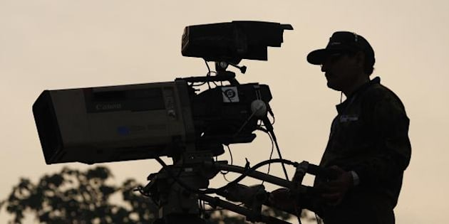 India's national TV channel. Taking up vantage camera positions.