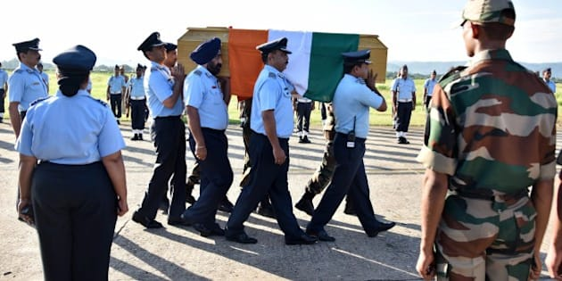 Indian Air Force officials and Indian Army officials carry a casket bearing the body of former President of India APJ Abdul Kalam towards a waiting aircraft at an airforce base in Guwahati on July 28, 2015.  India's former president and top scientist A. P. J. Kalam, who played a lead role in the country's nuclear weapons tests, died on July 27, a hospital official said. He was 83. Kalam collapsed during a lecture at a management institute in the northeastern Indian city of Shillong, and was declared dead on arrival by doctors at Bethany hospital.   AFP PHOTO/BIJU BORO        (Photo credit should read BIJU BORO/AFP/Getty Images)
