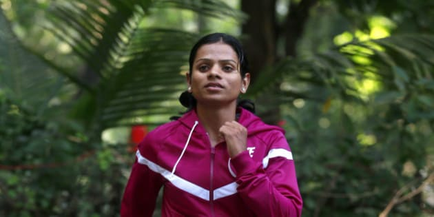 In this Wednesday, Oct. 29, 2014 photo, Indian athlete Dutee Chand poses for the Associated Press in Mumbai, India. The 18-year-old has now decided to fight the ban for 'hyperandrogenism' or the presence of high levels of testosterone in the body that makes the sprinter ineligible to compete according to International Association of Athletics Federation rules. Chand won two gold medals at the Asian junior track and field championship. (AP Photo/Rafiq Maqbool)