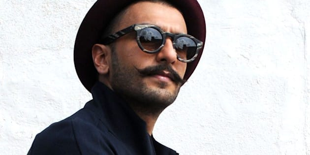 Indian Bollywood actor Ranveer Singh poses during a promotional event of the forthcoming Hindi film Dil Dhadakne Do in Mumbai on May 27, 2015.   AFP PHOTO/STR        (Photo credit should read STRDEL/AFP/Getty Images)
