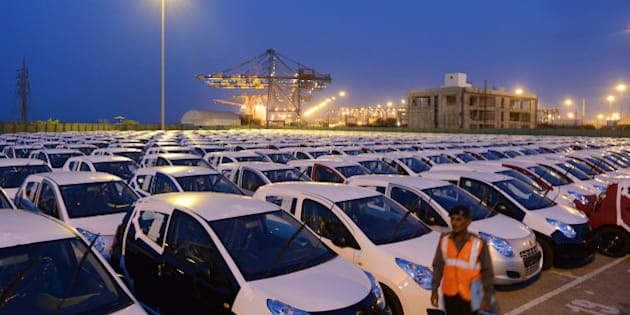 Maruti Suzuki Alto cars to be exported out of India are parked in a holding area at Adani Ports and Special Economic Zone (APSEZ) in Mundra, some 400 kms from Ahmedabad.  The country's largest car-maker Maruti Suzuki India from Japan's Suzuki Motor Corp declared recently that domestic sales declined around 14 percent in May, while exports fell 27.1 percent.  Adani Ports and Special Economic Zone Limited (APSEZ) is India's largest private port and special economic zone.  AFP PHOTO / Sam PANTHAKY        (Photo credit should read SAM PANTHAKY/AFP/Getty Images)