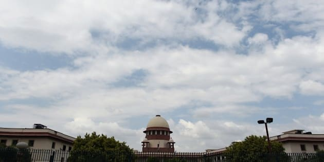 A view of the Indian Supreme Court in New Delhi on July 28, 2015.  India's Supreme court has referred Yakub Memon's petition against his death sentence for his role in the 1993 Mumbai bomb blasts to a larger bench after a two judge bench delivered a split verdict. AFP PHOTO / SAJJAD HUSSAIN        (Photo credit should read SAJJAD HUSSAIN/AFP/Getty Images)