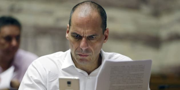 Parliament member Yanis Varoufakis checks his cell phone before a meeting with lawmakers of Syriza party at the Greek Parliament in Athens, Friday, July 10, 2015. Greece's Prime Minister Alexis Tsipras will seek backing for a harsh new austerity package from his party Friday to keep his country in the euro — less than a week after urging Greeks to reject milder cuts in a referendum. (AP Photo/Thanassis Stavrakis)