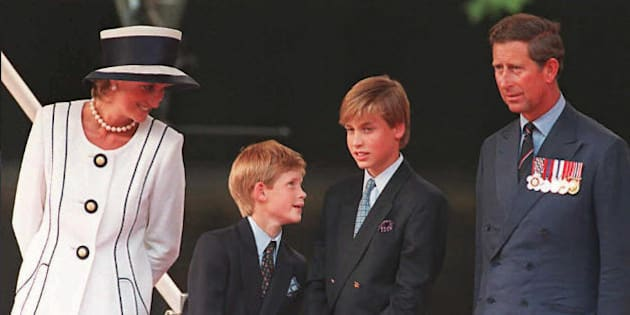 Princess Diana(L), her sons Harry(2nd L) and William(2nd R), and Prince Charles(R) watch the parade march past as part of the commemorations of VJ Day 19 August in London. The commemoration was held outside Buckingham Palace and was attended by 15,000 veterans and tens-of-thousands of spectators.  AFP PHOTO (Photo credit should read JOHNNY EGGITT/AFP/Getty Images)