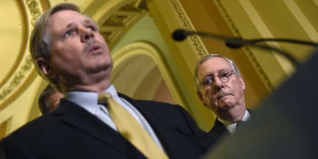 Senate Majority Leader Mitch McConnell of Ky. listens at right as Sen. John Hoeven, R.N.D. speaks during a news conference on Capitol Hill in Washington, Tuesday, Jan. 13, 2015, following a Republican policy luncheon. (AP Photo/Susan Walsh)