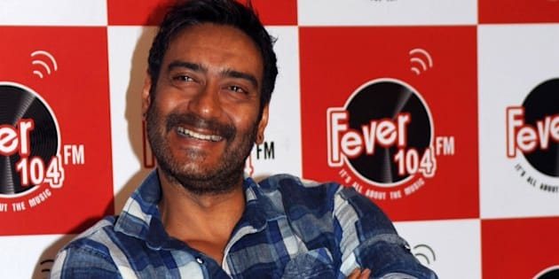 Indian Bollywood actor Ajay Devgn poses as he takes part in a promotional event visit to Fever 104 FM Studios ahead of the forthcoming Hindi film Drishyam directed by Nishikant Kamat in Mumbai on July 8, 2015.   AFP PHOTO/STR        (Photo credit should read STRDEL/AFP/Getty Images)