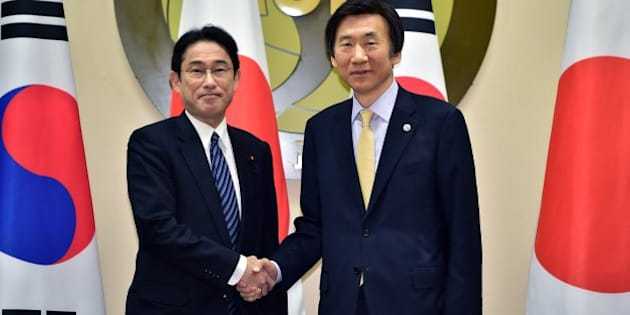 South Korean Foreign Minister Yun Byung-se, right, shakes hands with his Japanese counterpart Fumio Kishida, left, during their meeting at the foreign ministry in Seoul Saturday, March 21, 2015.  The foreign ministers of South Korea, China and Japan will meet for the first time in three years this weekend after bitter disputes over history and territory drastically scaled back high-level contacts and even raised security fears. (AP Photo/Jung Yeon-je, Pool)