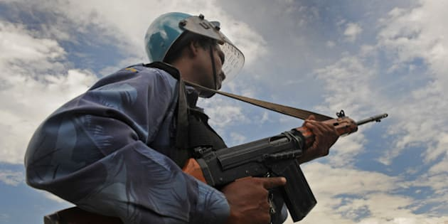 Indian soldier from Rapid Action Force (RAF) stand guard during a protest in Srinagar on August 17, 2010. Stone-hurling protesters fought police Tuesday after the death of a young man injured in a clash with security forces in restive Indian Kashmir, police said. The latest death brought to 58 the number of protesters and bystanders killed in two months of violent protests in the mainly Muslim region, most of them young men or teenagers shot dead by security forces. The man had been injured in southern Anantnag town Friday and died in hospital Tuesday, police said. The man had been injured in southern Anantnag town Friday and died in hospital Tuesday, police said.AFP PHOTO/Tauseef MUSTAFA (Photo credit should read TAUSEEF MUSTAFA/AFP/Getty Images)