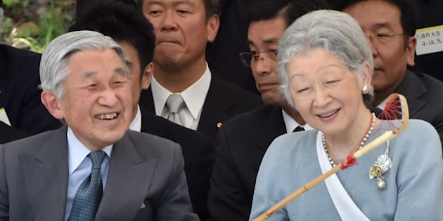Japanese Emperor Akihito (L) and Empress Michiko (R) attend the traditional horsemanship viewing, ancient Japanese polo and pennants streaming, at the Imperial Palace in Tokyo on May 30, 2015. The viewing is held in commemoration of the 80th birthday, 'sanju' of the Emperor and Empress.      AFP PHOTO / KAZUHIRO NOGI        (Photo credit should read KAZUHIRO NOGI/AFP/Getty Images)