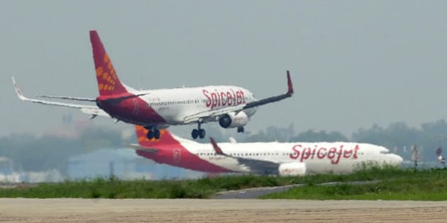 Aircraft from Spicejet jostle for space on a runway at Indira Gandhi International Airport in New Delhi on July 13, 2011.   Boeing have projected India would require about 1,300 commercial planes worth USD150 billion in the next two decades to meet the demands of its growing and more affluent population. The forecast from the world's largest aerospace company was 15 percent higher than projections of 1,150 planes for USD130 billion Boeing announced in August 2010 for India's civil aviation market.   AFP PHOTO/RAVEENDRAN (Photo credit should read RAVEENDRAN/AFP/Getty Images)