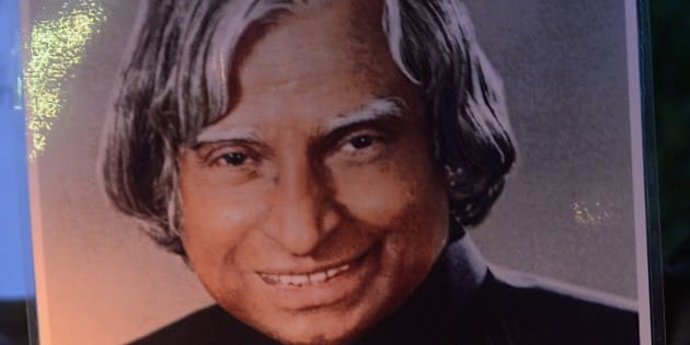 Indian students walk with a photograph of India's former president and top scientist A. P. J. Abdul Kalam during a candle light vigil in his memory in Mumbai on July 28, 2015. Avul Pakir Jainulabdeen Abdul Kalam, commonly known as India's missile man for his role in the country's nuclear weapons tests, collapsed during a lecture at a management institute in the northeastern Indian city of Shillong, and was declared dead on arrival by doctors at the city's Bethany hospital. India declared seven days of national mourning for Avul Pakir Jainulabdeen Abdul Kalam, who served as India's 11th president between 2002 and 2007, as is standard after the death of a former leader.  AFP PHOTO / INDRANIL MUKHERJEE        (Photo credit should read INDRANIL MUKHERJEE/AFP/Getty Images)