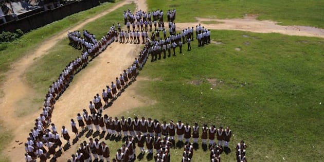 Indian school children form a missile during a condolence ceremony for former Indian President A.P.J. Abdul Kalam in Agartala, the capital of northeastern state of Tripura on July 28, 2015.  India's former president and top scientist A. P. J. Kalam, who played a lead role in the country's nuclear weapons tests, died July 28, a hospital official said. He was 83. Kalam collapsed during a lecture at a management institute in the northeastern Indian city of Shillong, and was declared dead on arrival by doctors at Bethany hospital.  AFP PHOTO/ ARINDAM DEY        (Photo credit should read ARINDAM DEY/AFP/Getty Images)