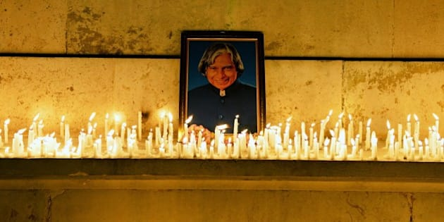 Students, staff and members of the faculty of the Indian Institute of Science pay a candle light tribute to former Indian president A.P.J. Abdul Kalam in Bangalore on July 28, 2015. Kalam, who played a lead role in the country's nuclear weapons tests, died July 28, a hospital official said. He was 83. AFP PHOTO/Manjunath KIRAN        (Photo credit should read MANJUNATH KIRAN/AFP/Getty Images)