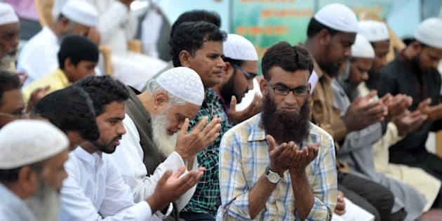 Indian Muslims offer special prayers for the death of executed convicted bomb plotter Yakub Memon, at Eidgah Ujaleshah in Hyderabad on July 30, 2015.   India executed convicted bomb plotter Yakub Memon for conspiring in the nation's deadliest attack, a series of blasts that killed hundreds in Mumbai more than two decades ago.  Memon was hanged at Nagpur jail in the western state of Maharashtra on his 53rd birthday after India's president and Supreme Court rejected 11th-hour appeals for clemency.   AFP PHOTO/NOAH SEELAM        (Photo credit should read NOAH SEELAM/AFP/Getty Images)