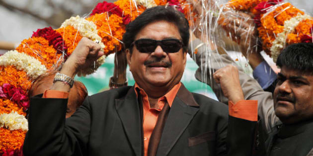 Bharatiya Janata Party leader and Bollywood actor Shatrughan Sinha, is garlanded in an election campaign rally  in Allahabad, India, Monday, Feb. 13, 2012. India's largest state Uttar Pradesh is currently going to the polls in seven-phases in a month long local election with repercussions for the whole nation. (AP Photo/Rajesh Kumar Singh)