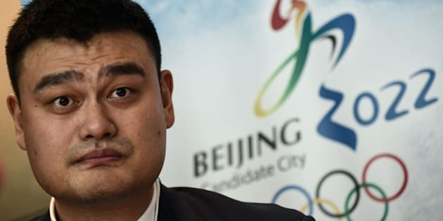 Retired Chinese professional basketball player Yao Ming looks on during a Beijing 2022 Olympics bid committee press briefing in Kuala Lumpur on July 29, 2015. Malaysia is hosting the 128th IOC session this week, with the 2022 Olympic Games bid between Beijing and Almaty in Kazakhstan to be decided by secret ballot in Kuala Lumpur.   AFP PHOTO / MANAN VATSYAYANA        (Photo credit should read MANAN VATSYAYANA/AFP/Getty Images)