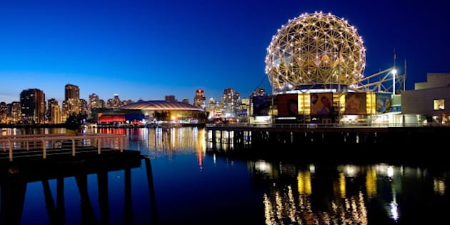 VANCOUVER, CANADA - FEBRUARY 18:  The TELUS World of Science geodesic dome and the city skyline are reflected in the water February 18, 2009 in Vancouver, British Columbia, Canada.  Vancouver is the host city for the 2010 Winter Olympic Games being held February 12-28, 2010.  (Photo by Robert Giroux/Getty Images)