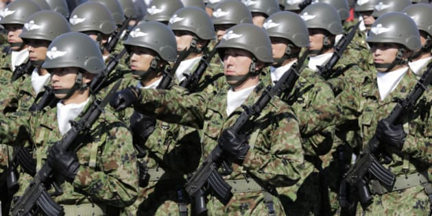 FILE - In this Oct. 27, 2013 file photo, members of Japan Self-Defense Forces march during the Self-Defense Forces Day at Asaka Base, north of Tokyo. Several Asian nations are arming up, their wary eyes fixed squarely on one country: a resurgent China that's boldly asserting its territorial claims all along the East Asian coast. The scramble to spend more defense dollars comes amid spats with China over contested reefs and waters. Other Asian countries such as India and South Korea are quickly modernizing their forces, although their disputes with China have stayed largely at the diplomatic level.  (AP Photo/Shizuo Kambayashi, File)