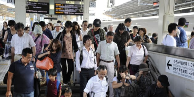 Thousands of holidaymakers return back to Tokyo by 'shinkansen', commonly known as the bullet train, at Tokyo station in the Japanese capital on August 14, 2011. Millions of Japanese make the traditional trek back to their hometowns from the cities during the 'Obon' holiday season every mid-August to follow the Buddhist custom of honoring the spirits of their ancestors, visiting family graves.   AFP PHOTO / TOSHIFUMI KITAMURA (Photo credit should read TOSHIFUMI KITAMURA/AFP/Getty Images)