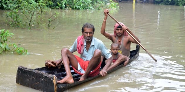 In this photograph taken on August 1, 2015, Indian villagers paddle a small boat through floodwaters in Bherampur Block, Murshidabad District, some 220kms north of Kolkata as the remnants of Cyclone Komen carrying heavy monsoon rains cross the eastern Indian state of West Bengal. Scores have perished in India, Nepal, Pakistan and Vietnam following floods and landslides triggered by heavy seasonal rains.  AFP PHOTO/STR        (Photo credit should read STRDEL/AFP/Getty Images)