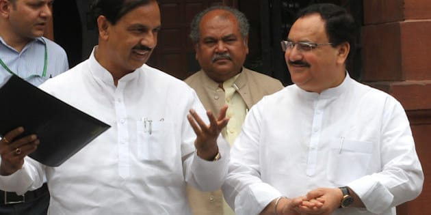 NEW DELHI, INDIA - JUNE 24: Union Minister for Arts and Culture Mahesh Sharma, Union Minister for Health and family Welfare JP Nadda, Union Minister for Steel Narendra Singh Tomar ( C ) coming out after Cabinet Meeting at Prime Minister Office, South Block on June 24, 2015 in New Delhi, India. (Photo by Arvind Yadav/Hindustan Times via Getty Images)