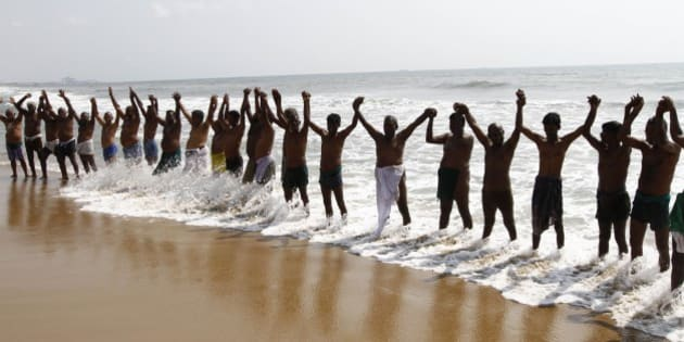 Indian farmers form a human chain on the shore of Bay of Bengal to protest against the ruling Bharatiya Janata Party's Land Acquisition Bill in Chennai, India, Wednesday, April 1, 2015. Opposition parties and farmers are protesting against the bill, calling it anti-farmer in a country where agriculture is the main livelihood of about 60 percent of the 1.2 billion people. (AP Photo/Arun Sankar K)