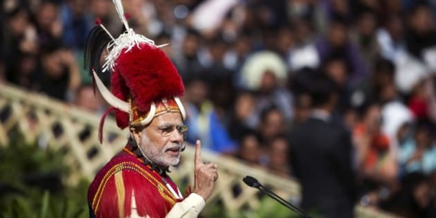 Indian Prime Minister Narendra Modi, in traditional Naga attire, speaks during the inaugural ceremony of the Hornbill festival in Kisama village in Nagaland, India, Monday, Dec. 1, 2014. The 10-day festival named after the Hornbill bird is one of the biggest festivals that showcases the rich tradition and cultural heritage of the indigenous Naga of India's northeast. (AP Photo/Anupam Nath)
