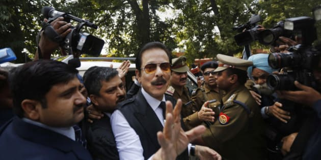 FILE - In this Tuesday, March 4, 2014 file photo, head of Sahara India conglomerate Subrata Roy speaks to the media as he arrives at the Supreme Court for a hearing in New Delhi, India. India's Supreme Court has rejected an appeal by the Indian tycoon accused of a multibillion dollar fraud to be released from jail and allowed house arrest. Roy has been jailed since the end of February on charges that his company failed to return billions of dollars to investors. (AP Photo/Altaf Qadri, File)