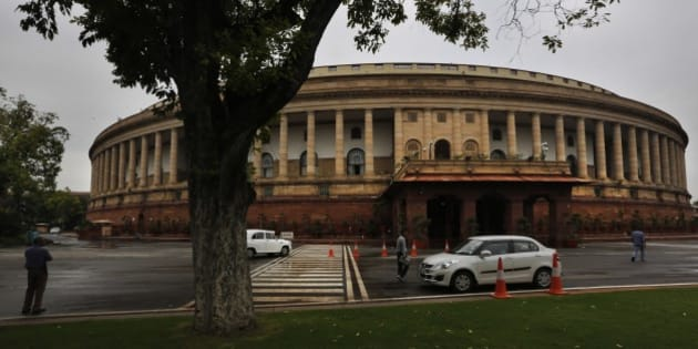 Indian Parliament house building is seen ahead of its monsoon session, in New Delhi, India, Monday, July 20, 2015. The session is scheduled to begin from July 21. (AP Photo/ Manish Swarup)