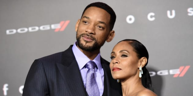 """Will Smith, left, and Jada Pinkett Smith arrive at the world premiere of """"Focus"""" at the TCL Chinese Theatre on Tuesday, Feb. 24, 2015, in Los Angeles. (Photo by Chris Pizzello/Invision/AP)"""