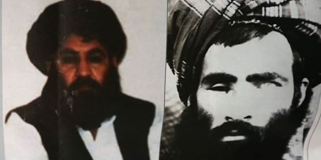 An Afghan newspaper headlines pictures of the new leader of the Afghan Taliban, Mullah Akhtar Mohammad Mansoor, left, and Mullah Mohammad Omar, in Kabul, Afghanistan, Saturday, Aug. 1, 2015. The new leader of the Afghan Taliban vowed to continue his group's bloody, nearly 14-year insurgency in an audio message released Saturday, urging his fighters to remain unified after the death of their longtime leader. (AP Photo/Rahmat Gul)