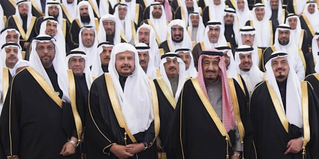 FILE - In this Tuesday, Jan. 6, 2015, file mage released by Saudi Press Agency, SPA, Saudi Arabia's Crown Prince Salman bin Abdulaziz Al Saud, 2nd right first row, poses with Shura members at consultative Shura Council in Riyadh, Saudi Arabia. Saudi Arabia's new monarch isn't wasting time. Since assuming the throne Jan. 23, King Salman has elevated some of his closest relatives and sidelined previous power-brokers, tightened decision-making and promised lavish payouts designed to win early goodwill. (AP Photo/Saudi Press Agency, File)