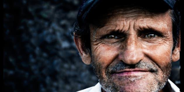 A very funny man:)  I was driving a bicycle among the villages near Sighetu Marmatiei, watching the people and their lifes, when he saw me driving with the camera in the hand and asked to stop me. He didn't speak english, but a mix of romanian-italian and stopped me to have a photo. I was really glad because I'm shy to ask people to pose for me. He was really really really FUNNY and surprised to see a guy driving a bycicle in his isolated village.  Un uomo troppo simpatico  Ero in bici tra i villaggi vicino a Sighetu Marmatiei,guardando la gente e la loro vita, quando questo omaccione mi ha visto guidare con la macchina fotografica in mano e mi ha chiesto di fermarmi.Non parlava inglese, ma un mix di romeno-italiano e mi ha fermato per avere una foto. Sono stato davvero felice perché mi intrippo parecchio di chiedere alle persone di posare per me (forse perchè mi scazza far perdere loro tempo e non riesco a fare un lavoro decente). E 'stato davvero davvero davvero simpatico e sorpreso di vedere un ragazzo alla guida di una bicicletta nel suo villaggio isolato.