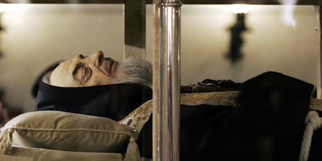 A silicon hand-painted bearded mask of the face of Padre Pio, an Italian saint, is seen on his body laying in repose inside a crystal casket in the crypt of the church of Santa Maria delle Grazie in San Giovanni Rotondo, Italy, Thursday, April 24, 2008. The body of Padre Pio, a hugely popular Italian saint, was put on public display Thursday, and thousands of people gathered to pray to the mystic monk who many Catholic faithful believe suffered wounds similar to those of Jesus' crucifixion. (AP Photo/Gregorio Borgia)