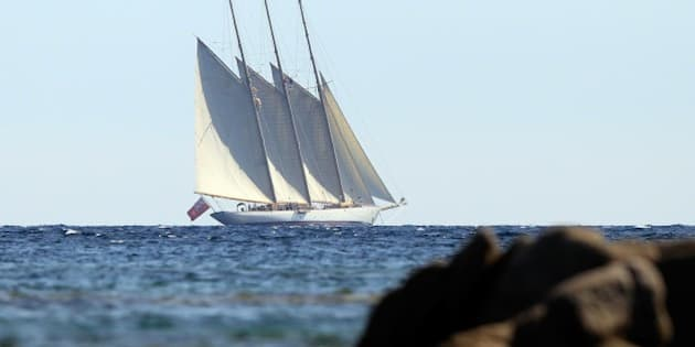 The yacht Adix, owned by Spanish Santander banking group and flying a British flag, sails off Testa beach on August 4, 2015, in Pianottoli Caldarello, Corsica, four days after French customs seized a Picasso on board considered a national treasure by Spain. The painting, which French customs said was valued at more than 25 million euros ($27 million), is owned by Jaime Botin, a well-known Spanish banker whose family founded Santander. An attempt to export the painting, 'Head of a Young Woman', to Switzerland last July 30 'drew the attention of French officials', the country's customs authorities said, with officers on the French Mediterranean island boarding the vessel the next day. AFP PHOTO / PASCAL POCHARD-CASABIANCA        (Photo credit should read PASCAL POCHARD CASABIANCA/AFP/Getty Images)