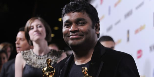 """Indian composer AR Rahman holds his two Oscars for Best Song and Best Original Score for """"Slumdog Millionaire"""" at the official Oscar After Party for Fox Searchlight's """"Slumdog Millionaire"""" and """"The Wrestler"""" in West Hollywood, Calif., Sunday, Feb. 22, 2009. (AP Photo/Chris Pizzello)"""